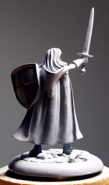 Photo of back of primed figure under a strong light.
