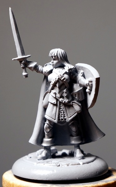 Photo of front of primed figure under a strong light.